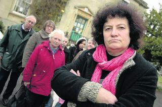 Christine Trueman, right, and other users outside Bury Knowle Library in Headington