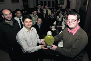 Club founder Gavin Hilton, right, presents the Golden Poppadum to Prakash Sharma