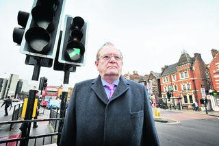 Oxfordshire County Council cabinet member Rodney Rose by traffic lights in Frideswide Square