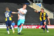 After making it 1-0, man-of-the-match Alfie Potter turns to celebrate with Simon Clist, who is already  exclaiming his delight ar Oxford United taking a deserved lead in their derby clash with Wycombe Wanderers, but the U's were unable to  hold their le