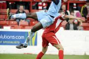 Oxford United defender Jimmy Sangare shows great committment to win a high ball at Accrington on Saturday