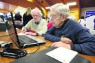 Howard Fuller, right, of the Oxfordshire Family History Society, helps Rowland Golby search records online