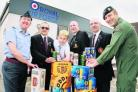 Pictured are Squadron Leader Nick Maxey, Brian Hughes, Nicholas Smith, Mr Lane, Steve Carver and Cpl Andy Coombes.