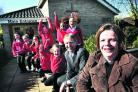 Headteacher Alison Holden, with interim executive board chairman Bob Wintringham and pupils