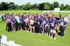 Barry Grinham, in the front row wearing number 100, and his team at last year's run
