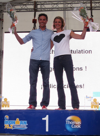 Emma-Kate Lidbury on the podium with men's winner Andreas Raelert