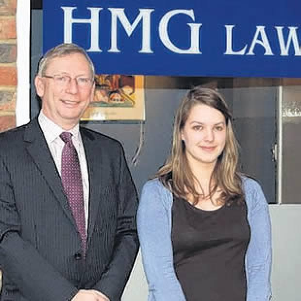 Chief executive of HMG Law Gary Baker with apprentice Jade Bowerman