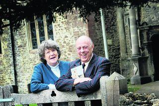 Christopher Walton, pictured with the Rev Pam McKellen outside Sunningwell Church,