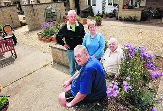 Residents, from left, Christopher Deane, Jonathan Keen, Agnes Crampton and Elsie Knipe in the communal garden