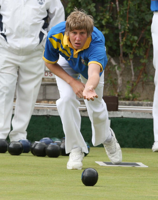 Oxfordshire debutant Robert Pink delivers this wood during skip Chris Earl's 21-20 rink win against Kent's Grant Allen