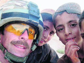 Sgt Alex Ford with Afghan children
