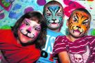 Kylie, eight, Matthew, 11, and Andrew Hone, five, from Wyatt Road, showing off their face painting