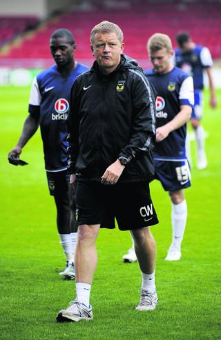 Chris Wilder leaves the pitch at Crewe on Saturday, with Jon-Paul Pittman close behind