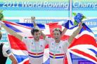 Great Britain's Zac Purchase (left) and Mark Hunter celebrate on the podium after winning the lightweight men's double sculls