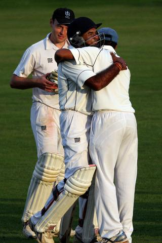 Thame hero Manoj Parmar is congratulated by teammate Jaydeep Bhatti with Sam Lachlan looking on