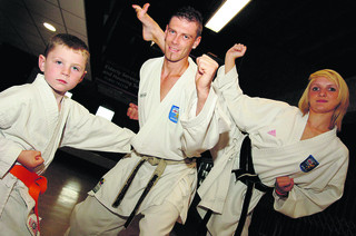 Instructor Phil Patrick with his five-year-old son Ashton Patrick and 15-year-old Dani Lester