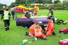 The Fire and Rescue Service work to free the car driver while ambulance medics attend to an 'injured' biker