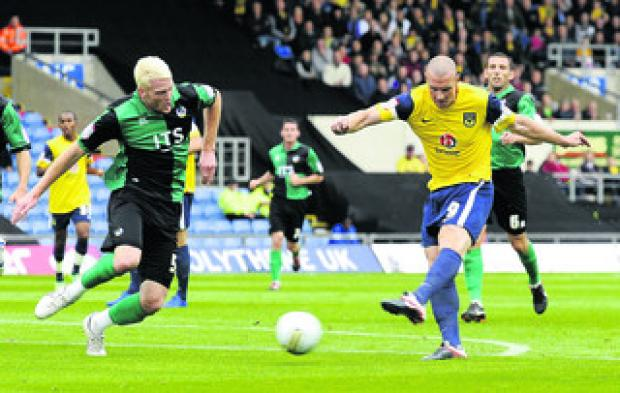 Oxford Mail: James Constable scores the opening goal against Bristol Rovers