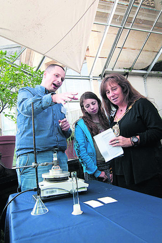 Fabrice Birembaut shows Lord Mayor of Oxford Elise Benjamin, with daughter Beri, the science behind compounds.