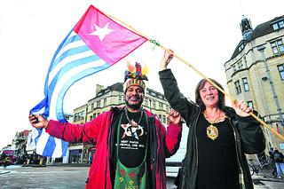 Benny Wenda of the Free West Papua Campaign flies his country's flag (banned in his homeland by the Indonesian Government) with Lord Mayor Elise Benjamin. The flag was due to be flown over the Town Hall