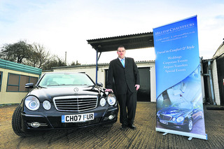 Nathan Thomas, owner of Hilltop Chauffeurs, with one of his cars
