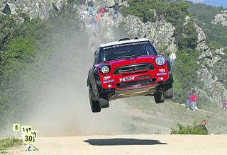 A Mini John Cooper Works rally car in action
