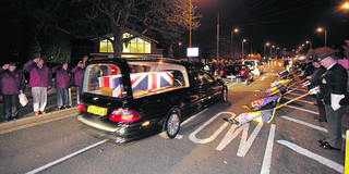 Crowds take to the street along Oxford's Headley Way to pay their respects to Private John King
