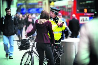 Pc Paul Smith with a cyclist in Queen Street