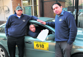 Private hire drivers, from left to right, Khalil Ahmed, Mukhtar Hussain and Mohsin Cheema with the petition against plans to video and sound record passengers in taxis