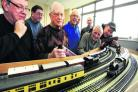 Keith Bristow, centre in blue, with fellow members of the model railway club and the new layout