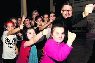 Tim Noble, with young dancers from west Oxfordshire including, front, from left, Elizabeth Ledgard-Hoiles, Lucy Pomeroy and Megan Hayes