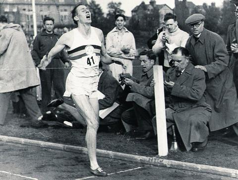 Sir Roger Bannister completes the first sub-four-minute mile at Oxford's Iffley Road Running Track on May 6, 1954