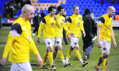 United's players trudge off at the final whistle
