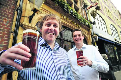 Manager James Dixon, left, and Bath Ales' retail director Robin Couling at the Grapes