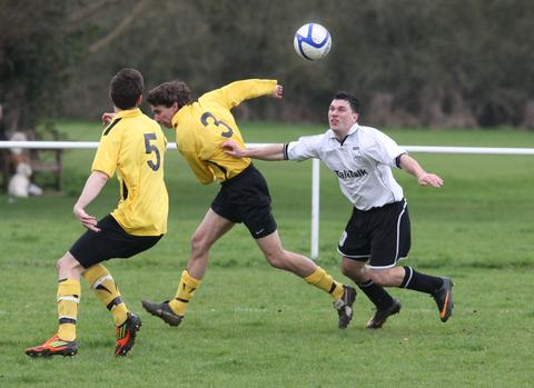 Eynsham's Danny Taylor holds off John Armstrong in the 3-3 draw with Oakley United