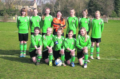 Kidlington Under 12s' line-up. Back row (from left): Annabelle Munday, Clara Emmett, Amberley Vircavs, Eleanor Whitfield, Kylie Pearson, Harriet Thomas, Sophie Whealy. Front: Milly Simmonds, Esme Murphy, Lucy Durham, Nicola Vincent, Abigail Haynes