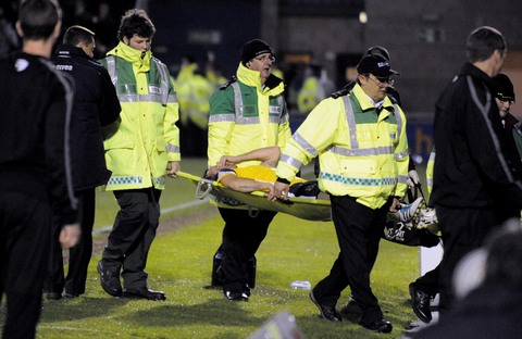 Oxford United's Peter Leven is stretchered off at Northampton
