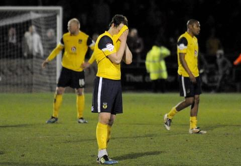 Oxford Mail: Adam Chapman buries his head in his shirt after seeing his second-half penalty saved