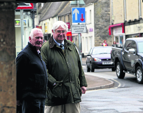 Councillors David Robertson, left, and David Harvey at the Buttercross in Witney