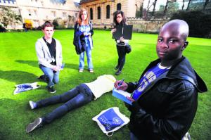 Murder in the Cloisters, part of an initiative to introduce teenagers to the university, took place in Pembroke College's North Quad. Pictured are, left to right, Jake Atkinson, Lara Curtin, Samantha Lawson and Darius Smith. Picture: OX51364 Jon Lewis