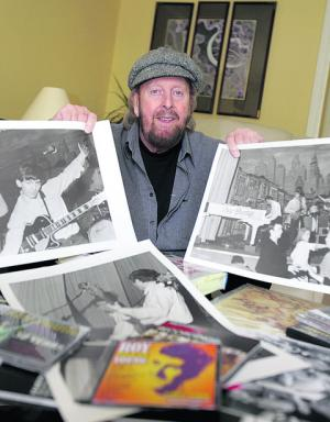 Musician Roy Young with some of his old photographs