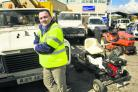 Maintenance officer Lee Wood with some of the vehicles for sale
