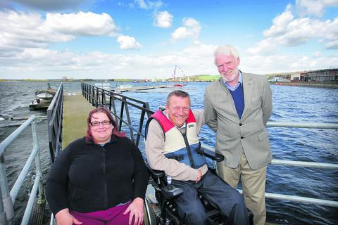 Ex-professional yachtsman Geoff Holt, who was paralysed in a swimming accident in 1984, officially opens the pontoon with Emma Crees and David Newton
