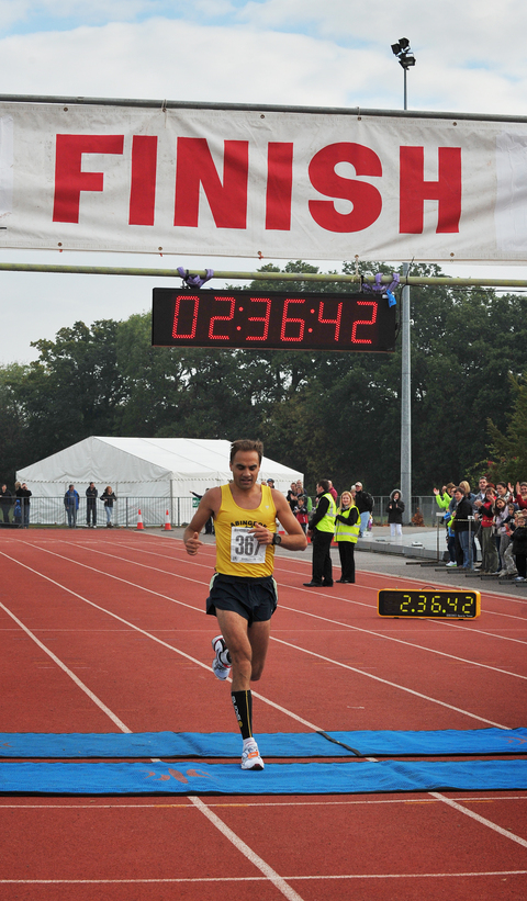 Paul Fernandez, seen here finishing third in the 2011 Abingdon Marathon, beat his personal best by three minutes in London