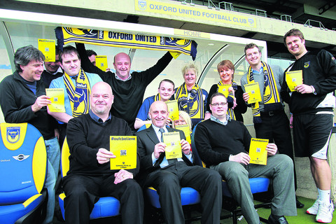 Oxford United staff show they're right behind the #oufcbelieve campaign, including communications officer Chris Williams, front left