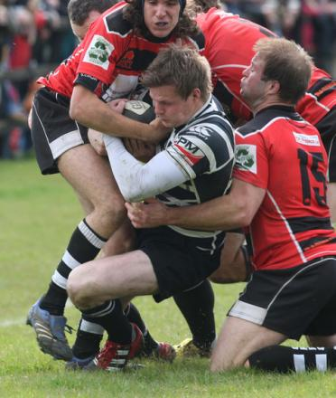 Chinnor wing Tom Gray shows the determination they will need to defeat Tonbridge Juddians