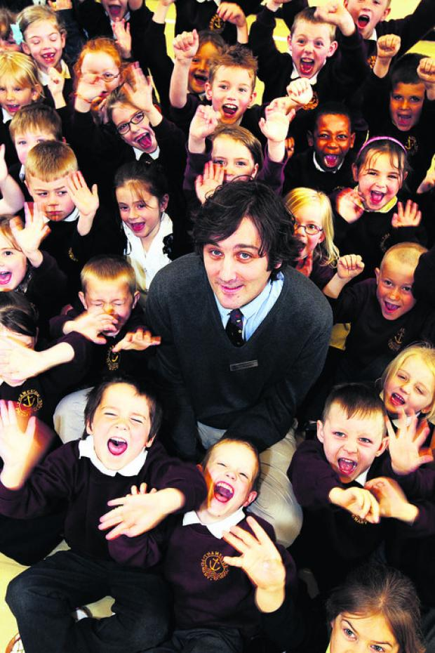 Thameside headteacher Joseph Rubba with pupils