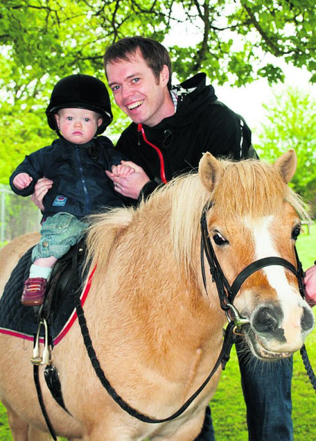 Enjoying a ride on the horse was 18-month-old Sam Garbutt, helped by his dad Ben.