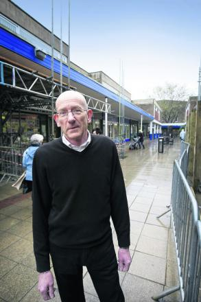 Ian Collett of The Bookstore in Abingdon where work is starting to revamp the shopping precinct