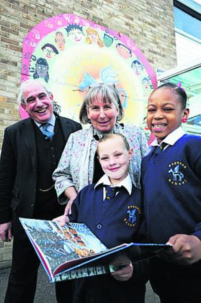 William Alden and headteacher Jill Hudson with keen readers Leya Parsons, left, and Shakayah Aamah at Pegasus School